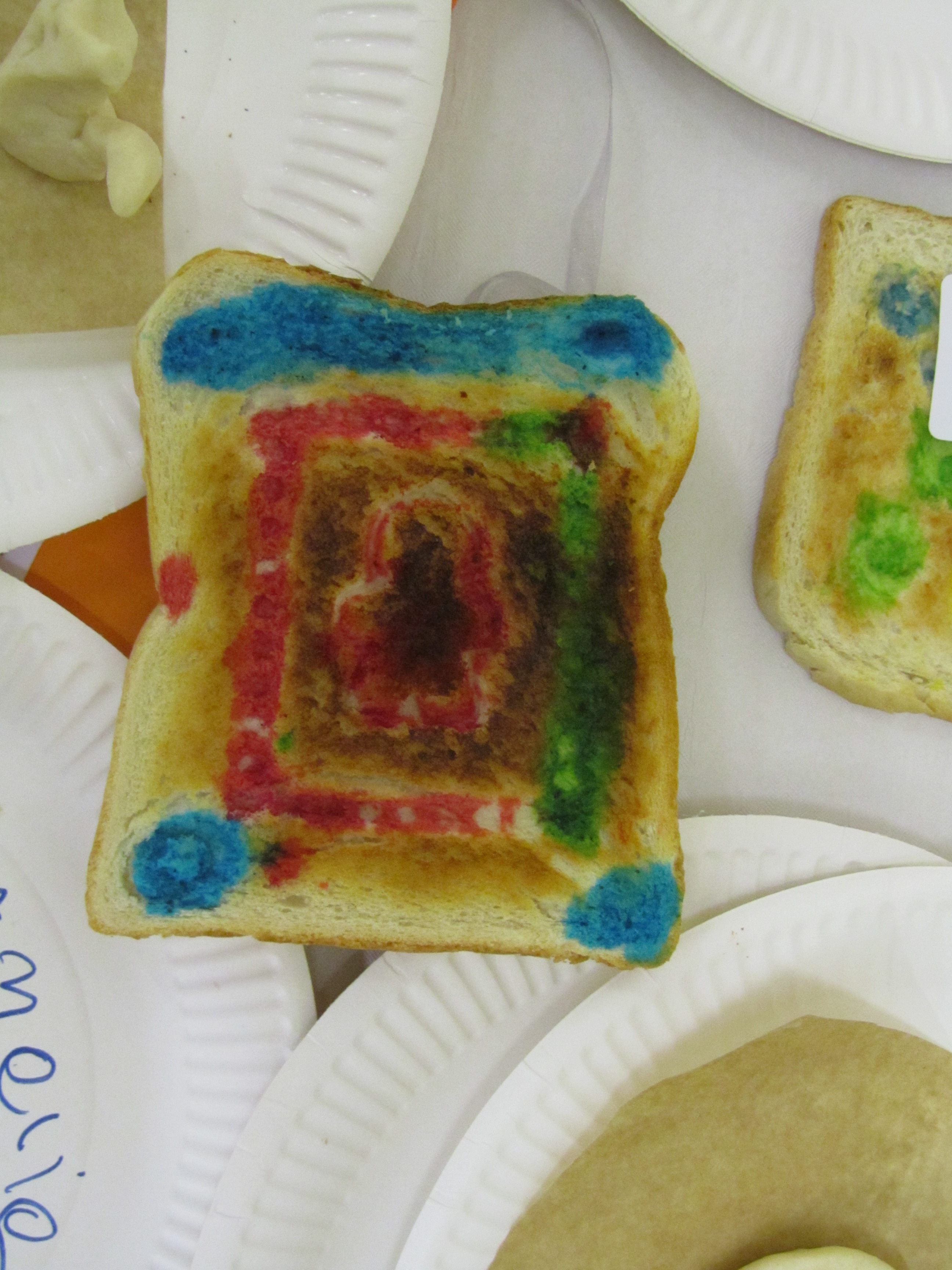 Imprinted and coloured toast